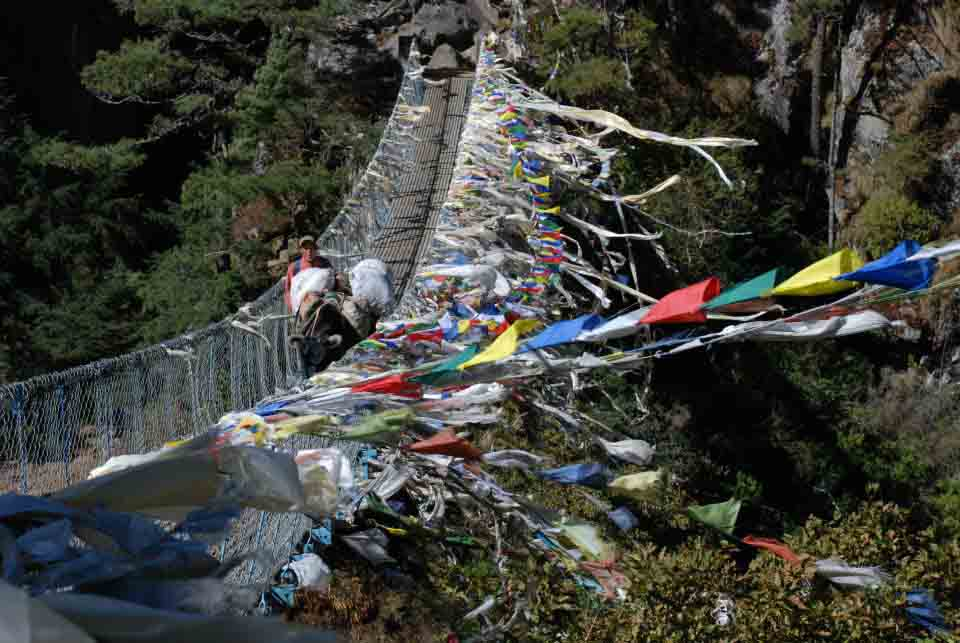 Prayer flags along a bridge on the Everest Base Camp trek