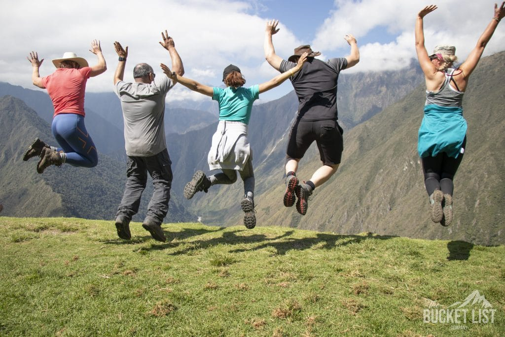 Group adventure travel - Bucketlist tekkers jump for joy in mountains