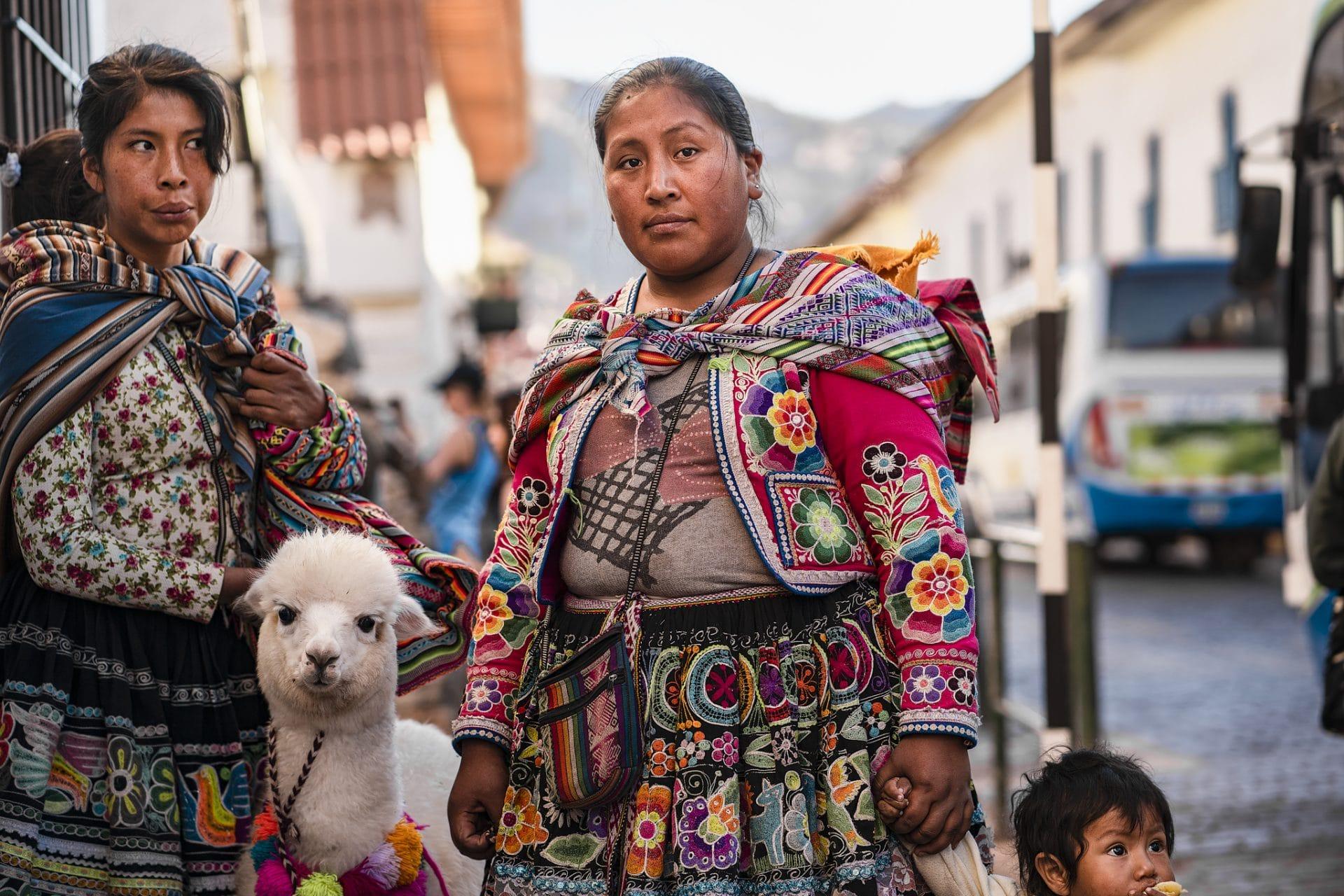 Local Quechua women and an alpaca in Cusco, Peru