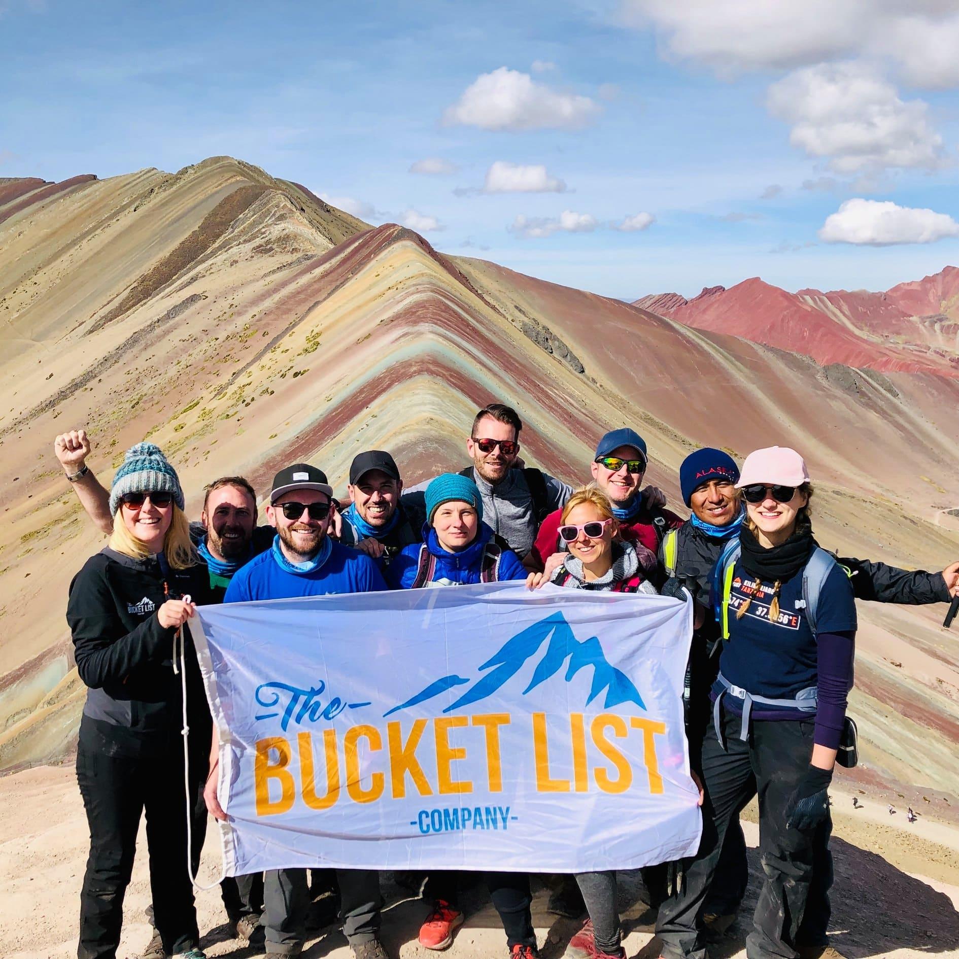 Bucket List group on top of Rainbow Mountain
