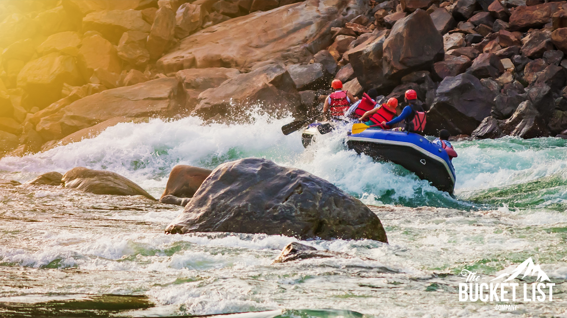 a group of adventurers on a raft in the rapids of Morocco